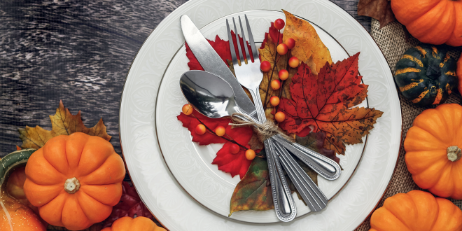 A Thanksgiving placesetting with decorative gourds